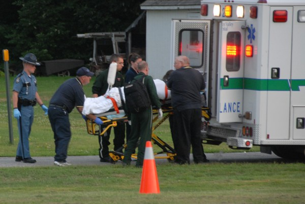An unidentified man reportedly shot during some kind of domestic disturbance at a home on Edinburg Road in Edinburg is taken from an ambulance to board a LifeFlight helicopter off Route 6 in Howland on Tuesday, Aug. 14, 2012.