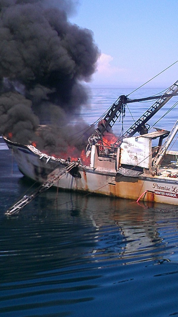 U.S. Coast Guard crew members from the Jonesport station rescued two fishermen and a boy from the 42-foot fishing vessel Promise Land, which caught fire 15 miles east of Jonesport on Thursday, Aug. 9, 2012.
