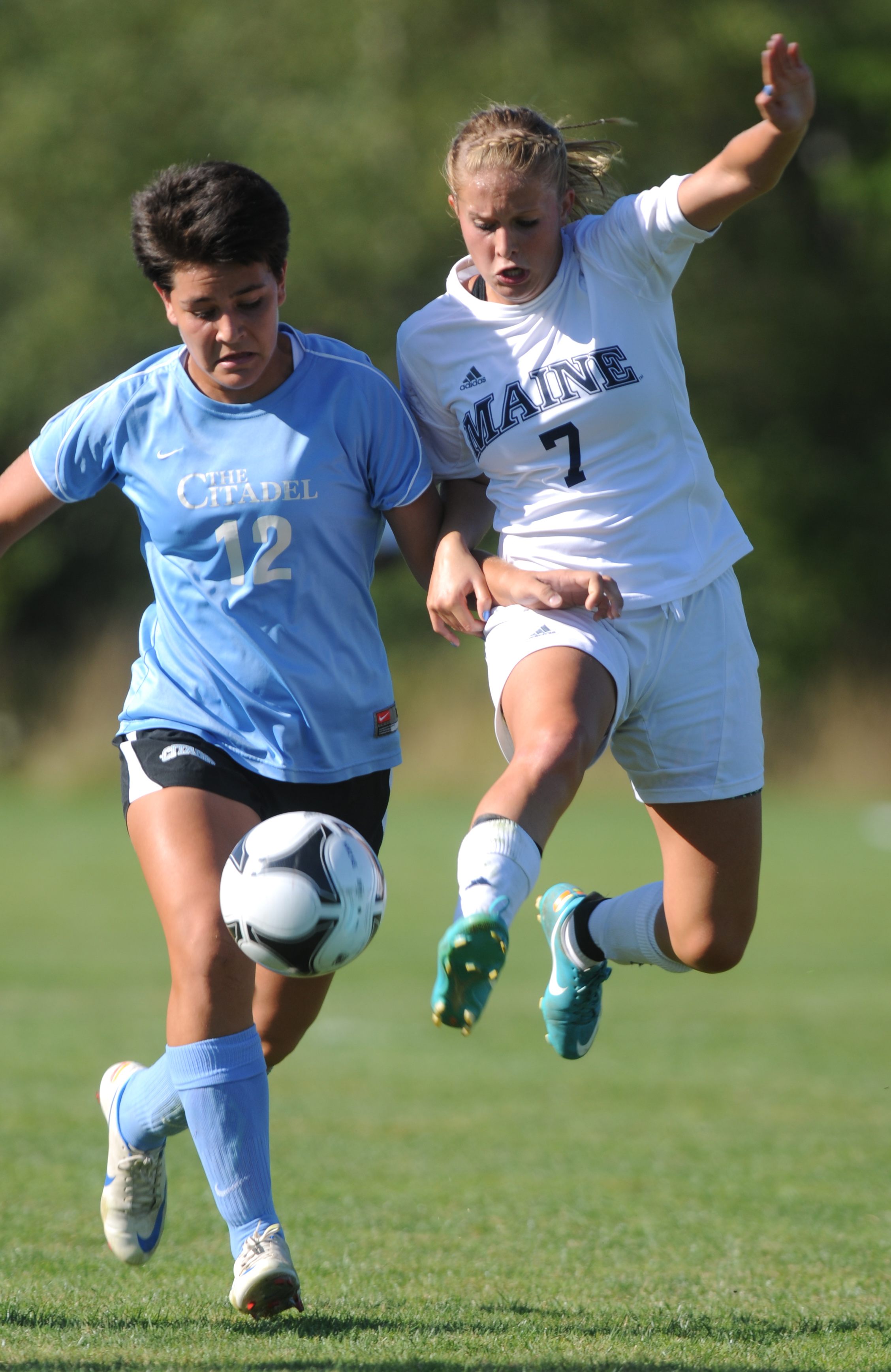UMaine's Jordan Pellerin and Citadel's Kimberly Maldonado fight for control of the ball during first-half action at Orono on Friday, Aug. 24, 2012.