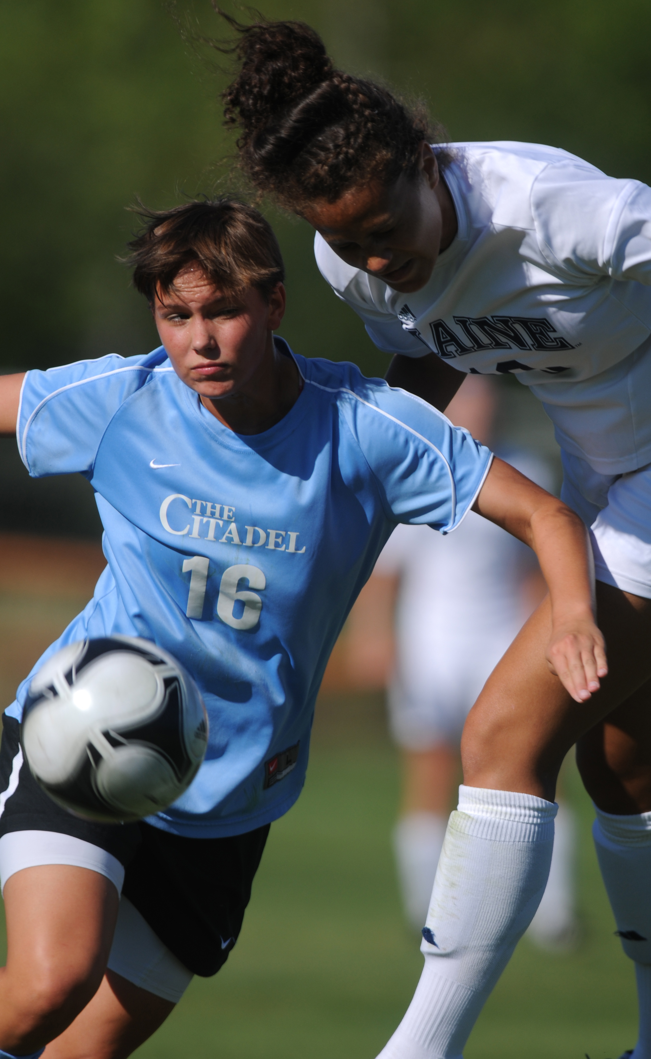 UMaine's Jordan Charlene Achille and Citadel's Taylor Darling fight for control of the ball during first-half action at Orono on Friday, Aug. 24, 2012.