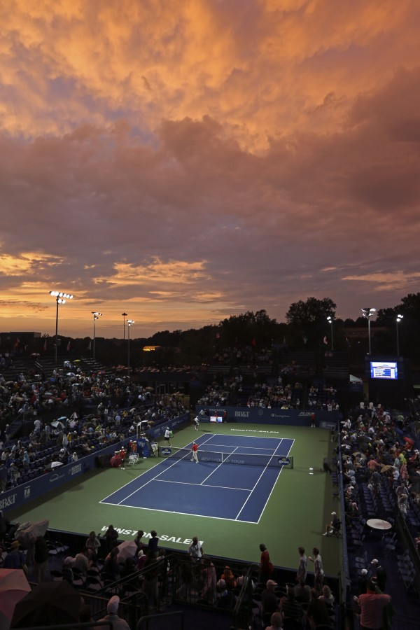 John Isner and Jurgen Melzer of Austria walk off the court before their third-round match in the Winston-Salem Open tennis tournament in Winston-Salem, N.C., on Wednesday, Aug. 22, 2012. Play was suspended due to weather conditions.