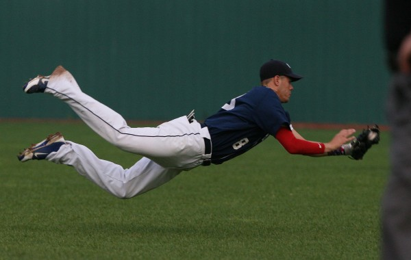 Bangor Comrades' third baseman Nic Cota dives to make a catch during the first inning against Gardiner during the state American Legion Tournament on Wednesday, Aug. 1, 2012 at the Ballpark in Old Orchard Beach.