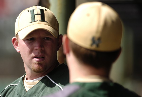 Husson University head baseball coach Jason Harvey talks with a player during a game in 2010 in Bangor. Harvey has been named an assistant athletic director at Husson.