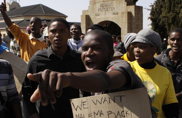 Protesters demonstrate outside the court in Ventersdorp, South Africa, on Wednesday, Aug. 22, 2012, at the sentencing of the killer of right-wing leader Eugene TerreBlanche. Chris Mahlangu was given a life sentence for the 2010 murder of TerreBlanche.