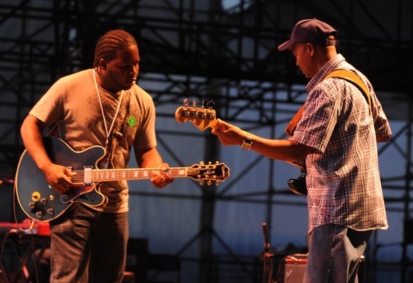 Bluesman Marquise Knox (left) and his bass player jam on the Railroad stage during the opening of the 2012 American Folk Festival on Friday, Aug. 24, 2012.
