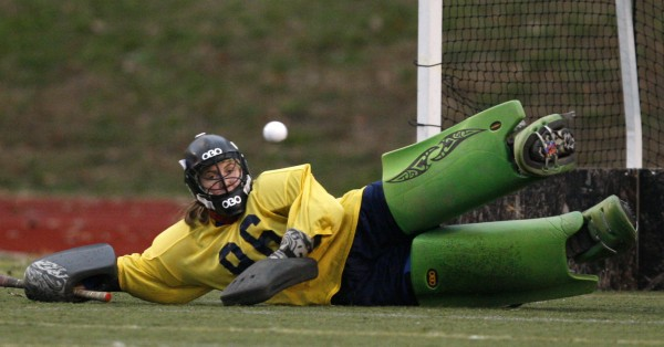 Belfast' goalie Julia Ward makes a save during her team's field hockey state championship victory over York in Yarmouth, Saturday, Oct. 29, 2011.