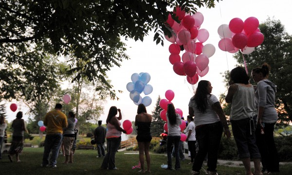 People gather at Cascade Park on Friday evening, Aug. 24, 2012 for a vigil for Nicolle Lugdon, one of the three victimes of the triple homecide car fire in Bangor on Aug. 13.