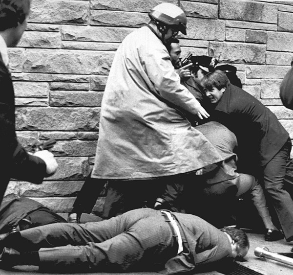 James Brady, President Reagan's press secretary, lies wounded on the sidewalk outside a Washington, D.C., hotel on March 30, 1981, after being shot during an attempt on President Reagan's life.