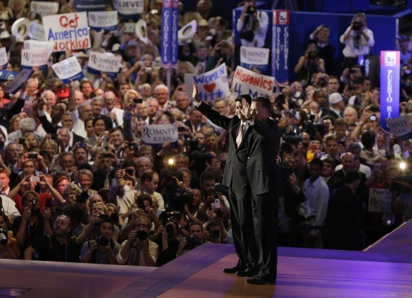 Republican vice presidential nominee, Rep. Paul Ryan, left, and Republican presidential nominee Mitt Romney wave to delegates after Romney's speech at the Republican National Convention in Tampa, Fla., on Thursday, Aug. 30, 2012.