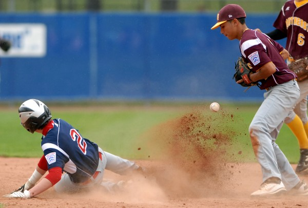 Asia-Pacific's Max Key is safe at second base as Southeast's Gabriel Rodriguez loses control of the ball in the seventh inning of the Senior Little League World Series game on Wednesday afternoon, Aug. 15, 2012. The U.S. Southeast team from Brevard County, Florida won the game 5-1.
