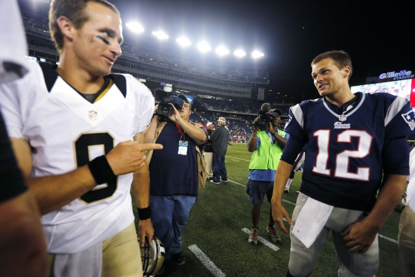 New Orleans Saints quarterback Drew Brees (9) points at New England Patriots quarterback Tom Brady (12) after the Patriots defeated the Saints 7-6 in an NFL preseason football game in Foxborough, Mass., Thursday, Aug. 9, 2012.