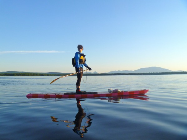 Bar Harbor native Amanda James crosses Upper Jo Mary Lake on her handcrafted wooden stand-up paddle board in mid-July 2012.