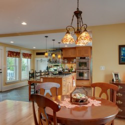 Bangor home with open floor plan and country kitchen