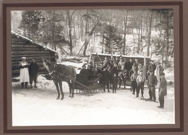 A typical lumber camp crew in the late 1800s. Note the camp cook with his white hat at far left. Photo courtesy of the Moosehead Historical Society