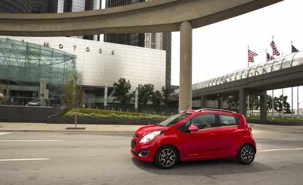 The 2013 Chevrolet Spark drives through the streets of Detroit, Michigan during a media event Thursday, August 2, 2012.