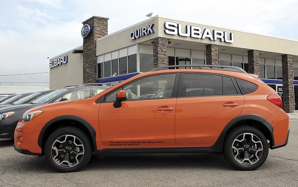 Painted Tangerine Orange Pearl, the five-door 2013 Subaru XV Crosstrek appeared at Quirk Subaru in Bangor earlier this month. Not scheduled to arrive on showroom floors until October 2012, the Crosstrek is a partial zero emission vehicle that delivers good gas mileage (33/25). Designed as a compact crossover, the Crosstrek has 8.7 inches of ground clearance.
