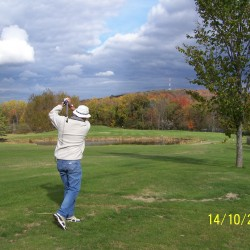 A golfer tees off on the first hole at Dexter Municipal Golf Course. The par-4 is the signature hole of the layout.