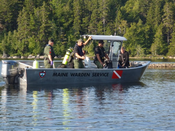 Members of the Maine Warden Service Dive Team search East Grand Lake in Danforth for Harry Dullys, 39, of New York, NY. Dullys' body was recovered Monday, Aug. 27, 2012 in 19 feet of water.