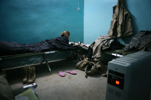 A female soldier rests in a bunk room in the castle where her platoon was stationed in Tal Afar, Iraq, January 2005.