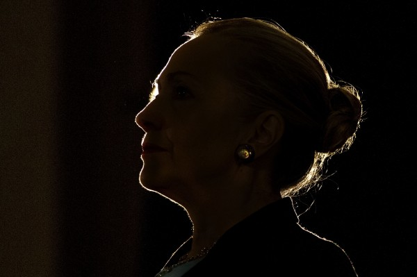 Silhouetted by a stage light, Secretary of State Hillary Rodham Clinton speaks at the University of the Western Cape about U.S.-South Africa partnership on Wednesday, Aug. 8, 2012, in Cape Town, South Africa.