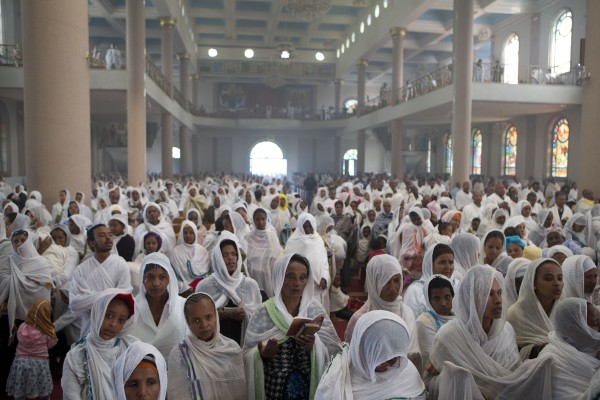 Ethiopian Orthodox faithful participate in Sunday Mass at Bole Medhane Alem Church, in Addis Ababa, Ethiopia on Sunday, Aug. 26, 2012.