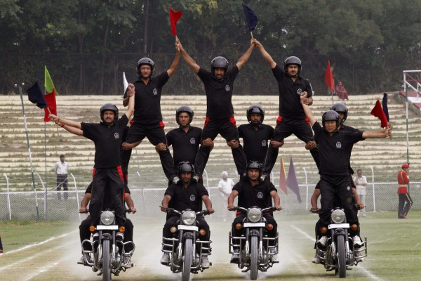 Jammu Kashmir police officers display their skills on motorcycles during a rehearsal for the Indian Independence Day celebrations in Srinagar, India on Monday, Aug. 13, 2012. India celebrates its 1947 independence from British colonial rule on Aug. 15.