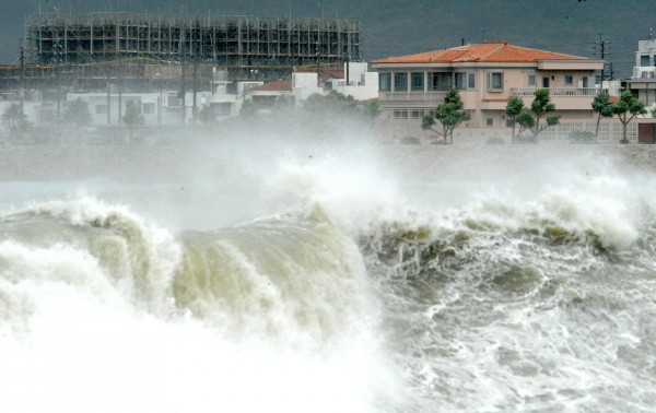 High waves pound the shore in Yonabarucho, Okinawa Prefecture, southern Japan, Sunday morning, Aug. 26, 2012. The strongest typhoon to hit Okinawa in several years lashed the island and surrounding areas Sunday, injuring several people and cutting off power to about 30,000 households.