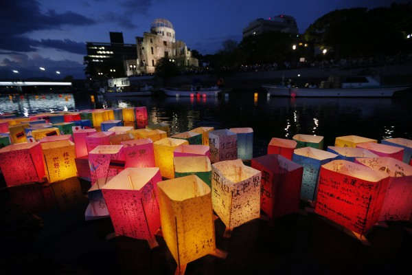 Paper lanterns float along the Motoyasu River in front of the illuminated Atomic Bomb Dome in Hiroshima, western Japan on Monday, Aug. 6, 2012. Hiroshima marks the 67th anniversary of the atomic bombing on Aug 6.