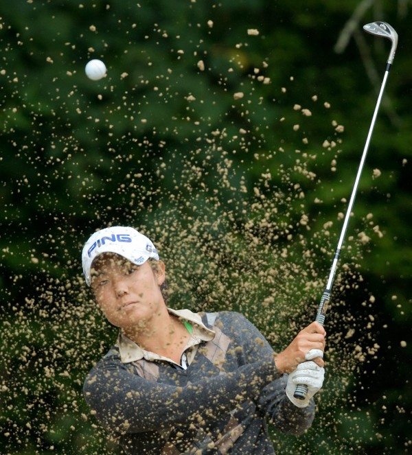 Tiffany Joh, of the United States, hits out of the sand on the 16th hole during the first round of the LPGA Tour's Canadian Women's Open golf tournament at Vancouver Golf Club in Coquitlam, British Columbia, on Thursday, Aug. 23, 2012.