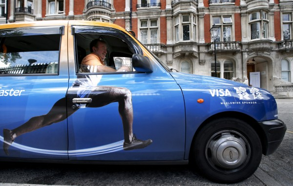 Taxi driver Richard Meid waits for a fare in front of the British Museum during the 2012 Summer Olympics on Wednesday, Aug. 8, 2012, in London.
