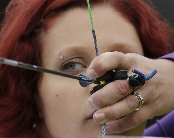 Canada's Marie-Pier Beaudet aims for the target during an elimination round of the individual archery competition at the 2012 Summer Olympics on Wednesday, Aug. 1, 2012, in London.