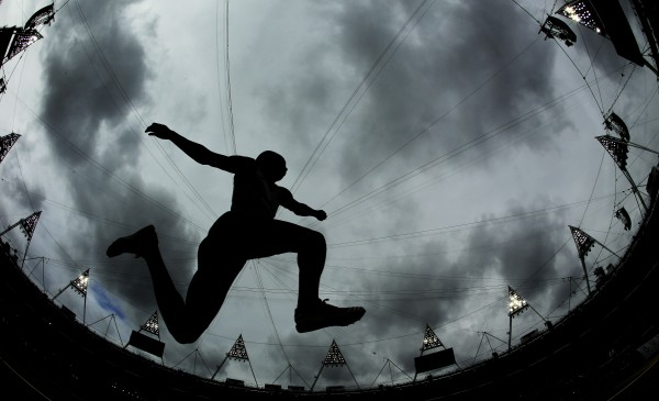 This picture taken with a fisheye lens shows France's Benjamin Compaore participating in the men's triple jump qualifying round during the athletics in the Olympic Stadium at the 2012 Summer Olympics in London on Tuesday, Aug. 7, 2012.
