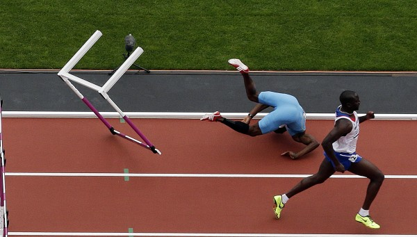 Bahamas's Shamar Sands falls after hitting a hurdle in the men's 100-meter hurdles during the athletics in the Olympic Stadium at the 2012 Summer Olympics in London on Tuesday, Aug. 7, 2012.