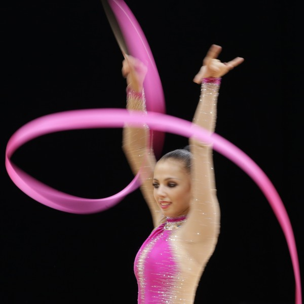Russia's Daria Dmitrieva performs during the rhythmic gymnastics individual all-around qualifications at the 2012 Summer Olympics on Friday, Aug. 10, 2012, in London.