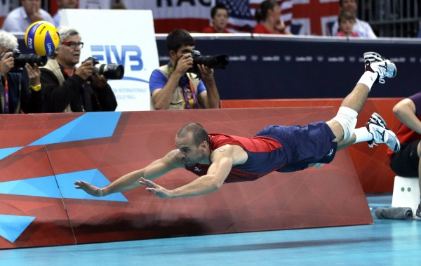 United States' Donald Suxho dives but cannot reach a ball during a men's quarterfinal volleyball match against Italy at the 2012 Summer Olympics on Wednesday, Aug. 8, 2012, in London.