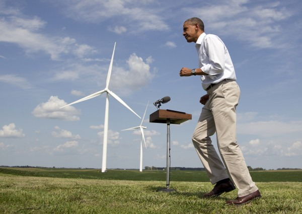 As wind turbines turn in the distance, President Barack Obama changes direction as he walks from a podium after speaking at the Heil family farm, Tuesday, Aug. 14, 2012, in Haverhill, Iowa, during a three-day campaign bus tour through Iowa.