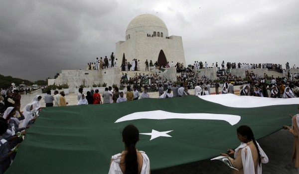 Students hold a huge Pakistani flag at mausoleum of Mohammad Ali Jinnah, the founder of Pakistan to mark Independence Day, in Karachi, Pakistan on Tuesday, Aug. 14, 2012. Pakistan celebrates its 66th Independence Day, to mark its independence from the British rule in 1947.