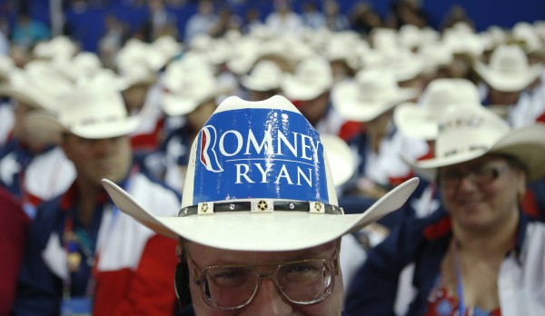 Texas delegate Clint Moore and the rest of Texas delegates fashion their cowboy hats at the Republican National Convention in Tampa, Fla., on Tuesday, Aug. 28, 2012.