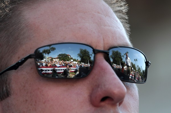 Republican presidential candidate, former Massachusetts Gov. Mitt Romney is reflected in a secret service agent's sunglasses during a campaign event at Flagler college, Monday, Aug. 13, 2012, in St. Augustine, Fla.