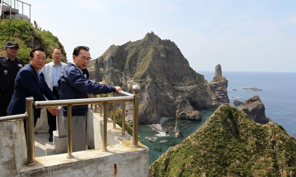 South Korean President Lee Myung-bak (right) visits islands called Dokdo in Korea and Takeshima in Japan on Friday, Aug. 10, 2012. Lee made a surprise visit Friday to islets at the center of a long-running territorial dispute with Japan, ignoring warnings from Tokyo that it would worsen the neighbors' already strained relations.