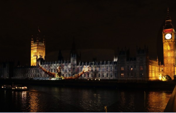 An image of Jamaican sprinter Usain Bolt is projected on the Parliament building at the 2012 Summer Olympics, Sunday, Aug. 5, 2012, in London. Bolt overwhelmed a star-studded field Sunday to win the 100-meter dash in 9.63 seconds, an Olympic record that let him join Carl Lewis as the only men with consecutive gold medals in the marquee track and field event at the Summer Games.