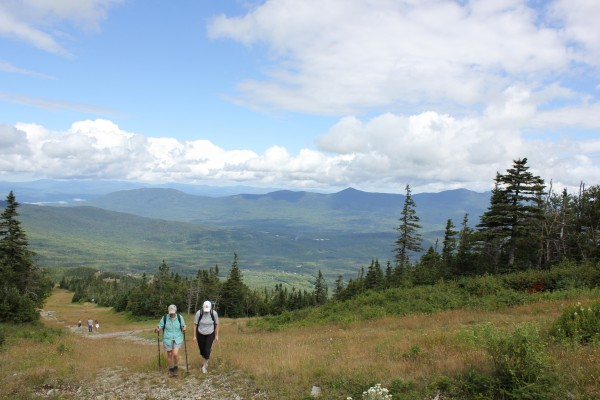 Maine Appalachian Trail Club member Janice Ronan and fellow hiker Carolyn Clark make their way to the summit of Sugarloaf Mountain in western Maine during the Appalachian Trail's 75th anniversary celebration on Saturday, Aug. 18, 2012.