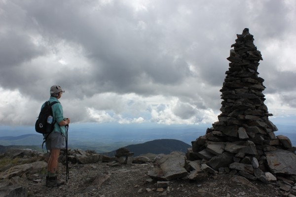 Maine Appalachian Trail Club member Janice Ronan stands at the summit of Sugarloaf Mountain, the state's second tallest mountain, during the Appalachian Trail's 75th anniversary celebration on Saturday, Aug. 18, 2012. As part of the celebration, guided hikes were organized to a plaque where the trail was completed between Sugarloaf and Spaulding Mountain.