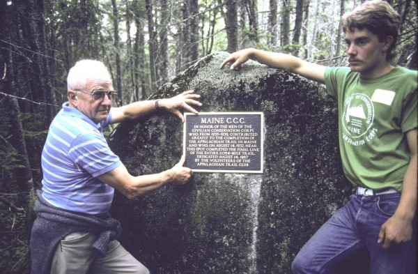 Miles Fenton, the only surviving member of the 1937 Civilian Conservation Corps crew that completed the final two miles of the Appalachian Trail, stands with CCC member Soren Siren by a plaque being placed on a boulder on the ridge between Sugarloaf Mountain and Spaulding Mountain on Aug. 14, 1987, during the trail's 50th anniversary. The plaque, dedicated to CCC, is located on the AT where the last section of trail was cleared in 1937.