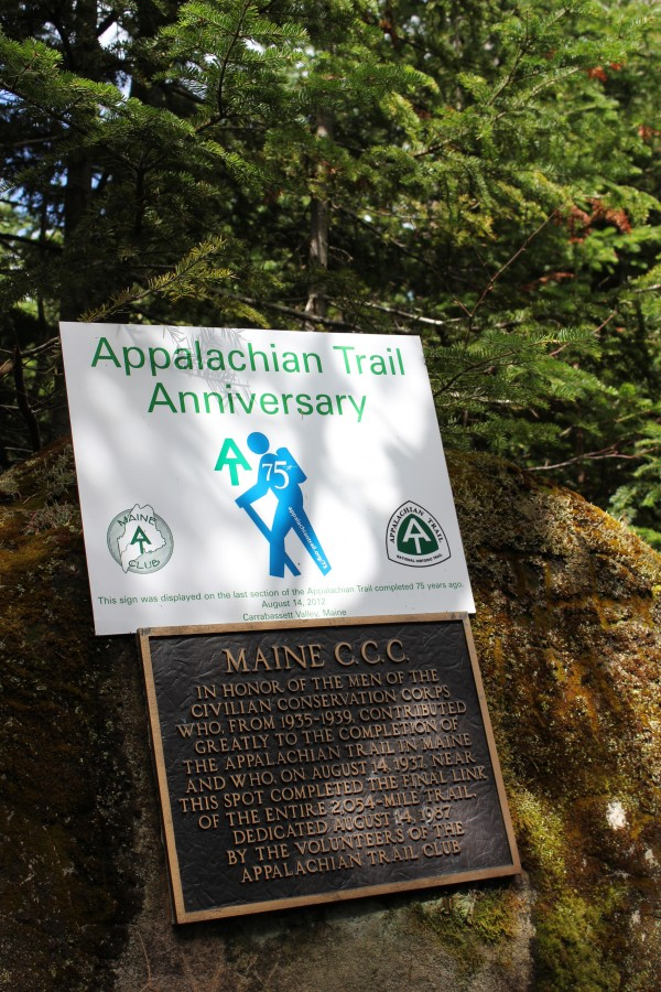 A commemorative plaque sits atop a permanent plaque dedicated to the Maine Civilian Conservation Corps for their work building Maine's Appalachian Trail on a boulder located beside the trail on the ridge between Sugarloaf and Spaulding Mountain in western Maine on Aug. 14, 2012, the day that outdoor enthusiasts gathered in Carrabassett Valley to celebrate the trail's 75th anniversary.