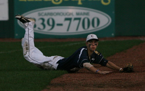 Bangor Comrades' Seth Freudenberger slides off the grass after making a catch during the third inning against First Title-Portland during the American Legion state tourney on Thursday, Aug. 2, 2012 at The Ballpark in Old Orchard Beach.