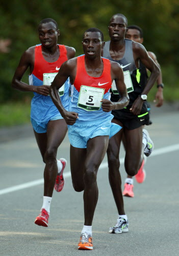Stanley Biwott of Kenya (center) joined by Stephen Kipkosgei-Kibet (left) of Kenya and Silas Kipruto (right) of Kenya takes the lead Saturday, Aug. 4, 2012, during the annual TD Bank Beach To Beacon 10K road race in Cape Elizabeth. Biwott went on to win the race, and Kipkosgei-Kibet finished in second place.