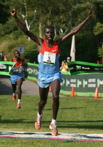 Stanley Biwott of Kenya crosses the finish line Saturday, Aug. 4, 2012, to win the annual TD Bank Beach To Beacon 10K road race in Cape Elizabeth.