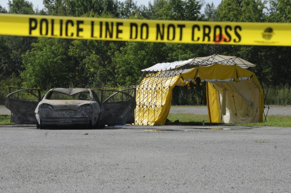 Police mobile crime vehicles were gone Tuesday morning, Aug. 14, 2012, but Bangor police still had the area secured with yellow crime tape.
