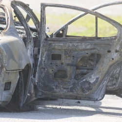 AG's office takes over burned-car case; Bangor police seek to identify person seen running from fire